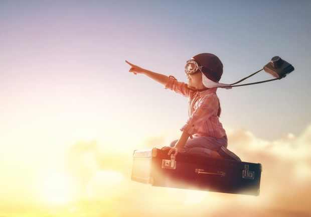 bigstock-Dreams-of-travel-Child-flying-124335935