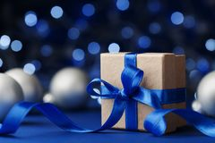 gift-box-present-christmas-balls-against-blue-bokeh-background-magic-holiday-greeting-card-gift-box-present-100516806
